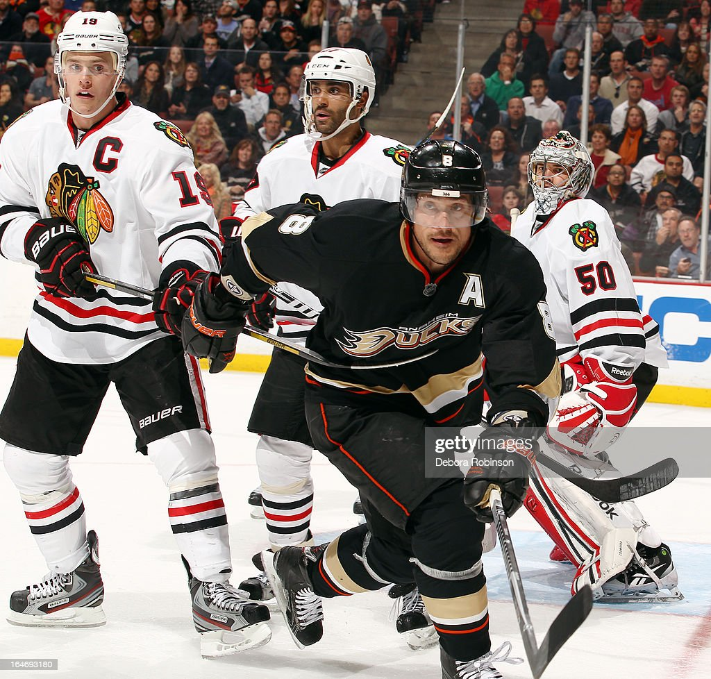 Teemu Selanne #8 of the Anaheim Ducks battles for position against Jonathan Toews #19, Johnny Oduya #27 and Corey Crawford #50 of the Chicago Blackhawks on March 20, 2013 at Honda Center in Anaheim, California.