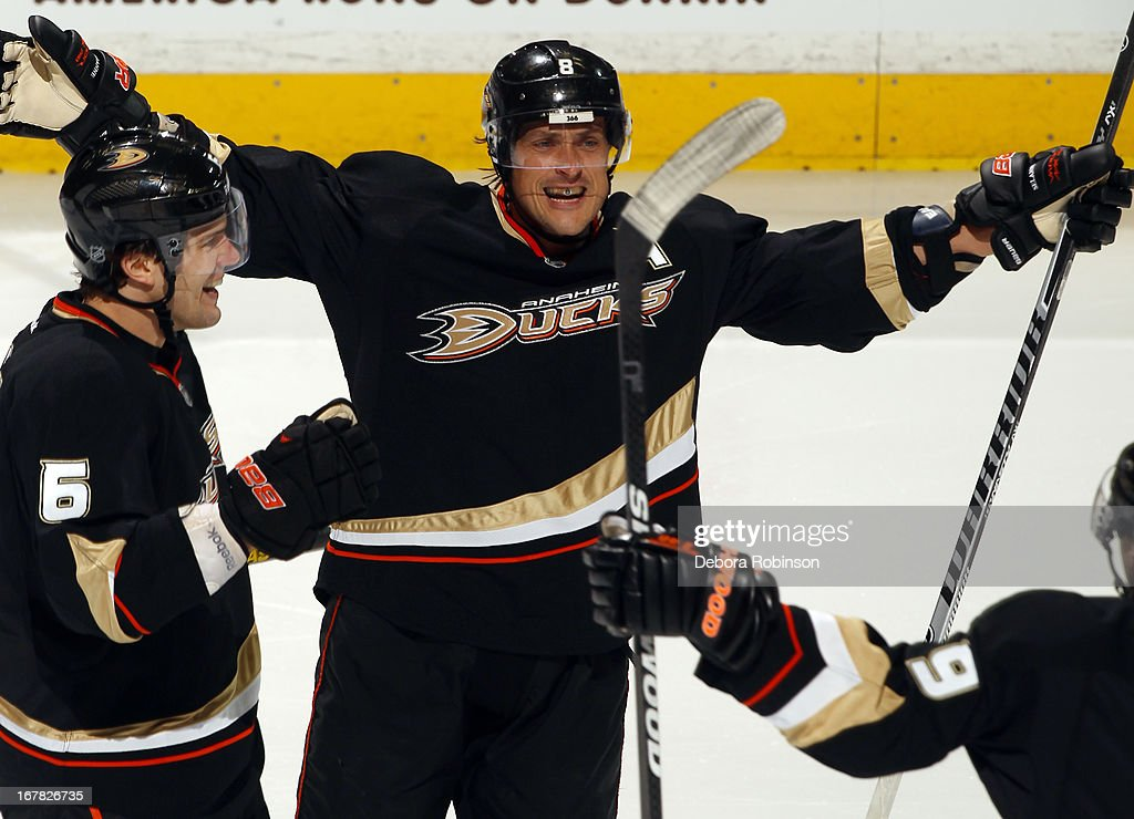 Teemu Selanne #8 of the Anaheim Ducks celebrates with <a gi-track='captionPersonalityLinkClicked' href=/galleries/search?phrase=Ben+Lovejoy&family=editorial&specificpeople=4509565 ng-click='$event.stopPropagation()'>Ben Lovejoy</a> #6 and <a gi-track='captionPersonalityLinkClicked' href=/galleries/search?phrase=Bobby+Ryan+-+Ice+Hockey+Player&family=editorial&specificpeople=877359 ng-click='$event.stopPropagation()'>Bobby Ryan</a> #9 after scoring a goal against the Detroit Red Wings in Game One of the Western Conference Quarterfinals during the 2013 NHL Stanley Cup Playoffs at Honda Center on April 30, 2013 in Anaheim, California.
