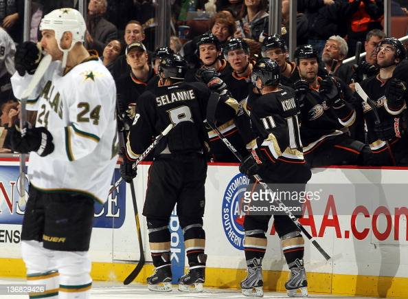 Teemu Selanne of the Anaheim Ducks celebrates with teammates after a goal by Saku Koivu against the Dallas Stars during the game on January 10 2012...
