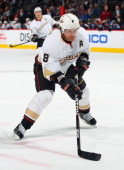 Teemu Selanne of the Anaheim Ducks collects the puck and scores against the Colorado Avalanche in the third period at the Pepsi Center on March 12...