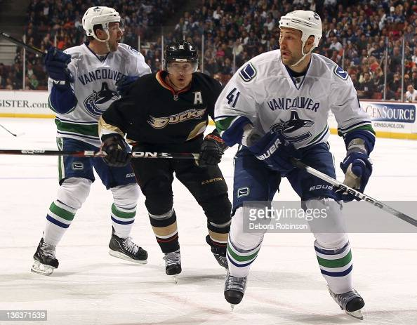 Teemu Selanne of the Anaheim Ducks defends against Andrew Alberts of the Vancouver Canucks during the game on December 29 2011 at Honda Center in...