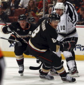Teemu Selanne of the Anaheim Ducks defends against Mike Richards of the Los Angeles Kings during the game on November 17 2011 at Honda Center in...