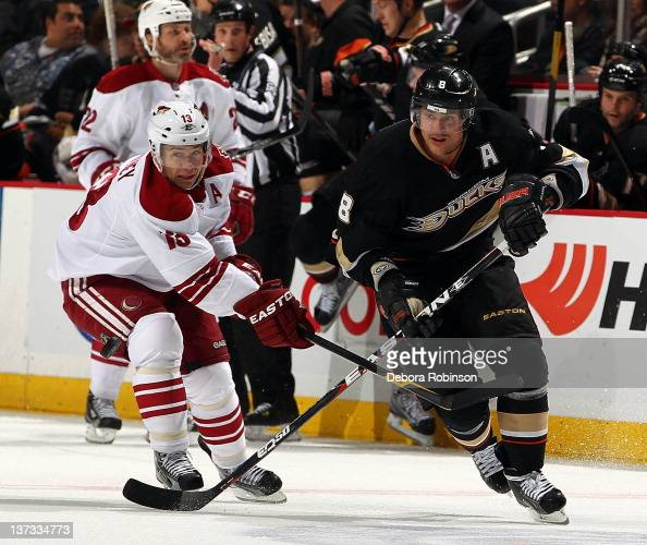 Teemu Selanne of the Anaheim Ducks defends against Ray Whitney of the Phoenix Coyotes during the game on January 18 2012 at Honda Center in Anaheim...