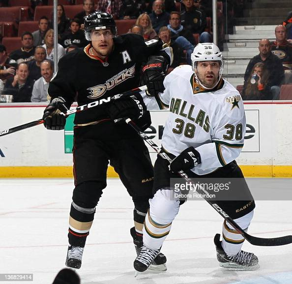 Teemu Selanne of the Anaheim Ducks defends against Vernon Fiddler of the Dallas Stars during the game on January 10 2012 at Honda Center in Anaheim...