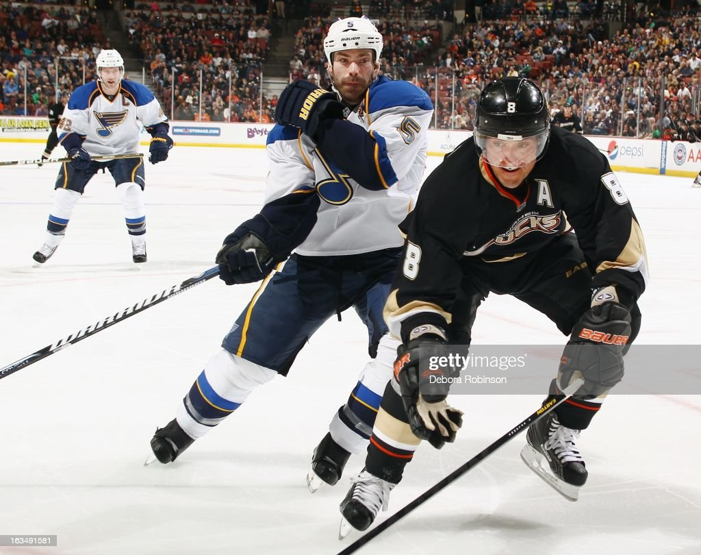 Teemu Selanne #8 of the Anaheim Ducks digs the puck off the glass against <a gi-track='captionPersonalityLinkClicked' href=/galleries/search?phrase=Barret+Jackman&family=editorial&specificpeople=213384 ng-click='$event.stopPropagation()'>Barret Jackman</a> #5 of the St. Louis Blues on March 10, 2013 at Honda Center in Anaheim, California.