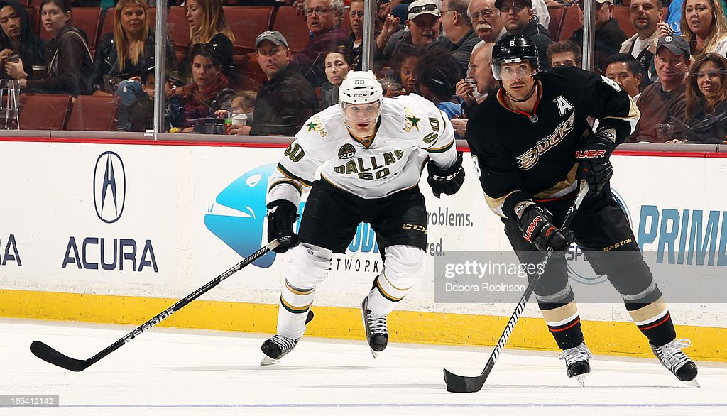 Teemu Selanne #8 of the Anaheim Ducks handles the puck against <a gi-track='captionPersonalityLinkClicked' href=/galleries/search?phrase=Antoine+Roussel&family=editorial&specificpeople=4202700 ng-click='$event.stopPropagation()'>Antoine Roussel</a> #60 of the Dallas Stars on April 3, 2013 at Honda Center in Anaheim, California.