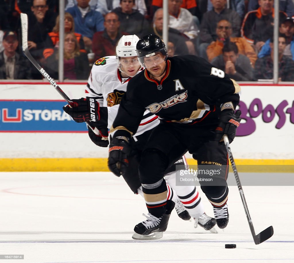 Teemu Selanne #8 of the Anaheim Ducks handles the puck against Patrick Kane #88 of the Chicago Blackhawks on March 20, 2013 at Honda Center in Anaheim, California.