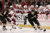 Teemu Selanne of the Anaheim Ducks handles the puck alongside the boards during the game against the Phoenix Coyotes on November 29 2009 at Honda...