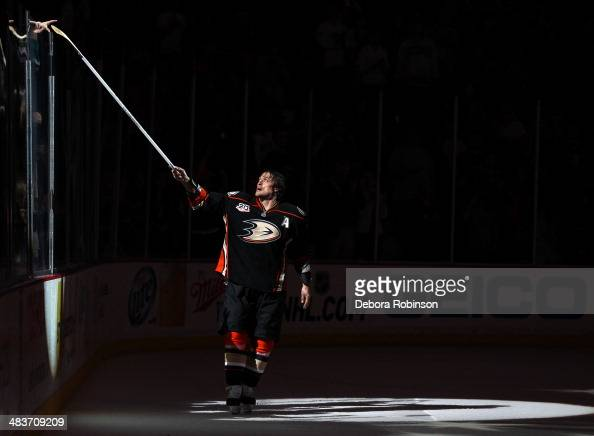 Teemu Selanne of the Anaheim Ducks hands his stick to a fan after the game against the San Jose Sharks on April 9 2014 at Honda Center in Anaheim...