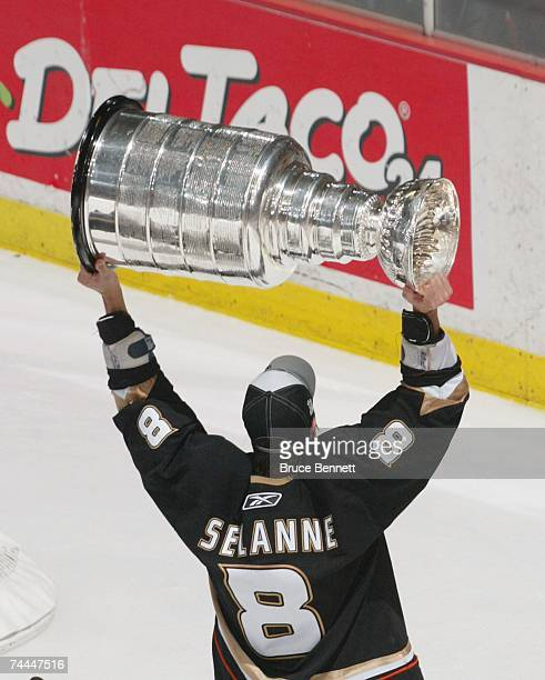 Teemu Selanne of the Anaheim Ducks hoists the Stanley Cup after his team's victory over the Ottawa Senators during Game Five on June 6 2007 at Honda...