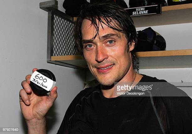 Teemu Selanne of the Anaheim Ducks holds up the puck with which he scored his 600th career NHL goal against the Colorado Avalanche after their NHL...