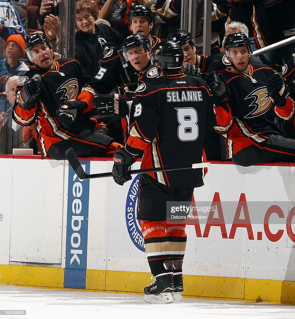 Teemu Selanne #8 of the Anaheim Ducks is congratulated by his teammates after scoring a goal during the game against the Minnesota Wild on March 1, 2013 at Honda Center in Anaheim, California.
