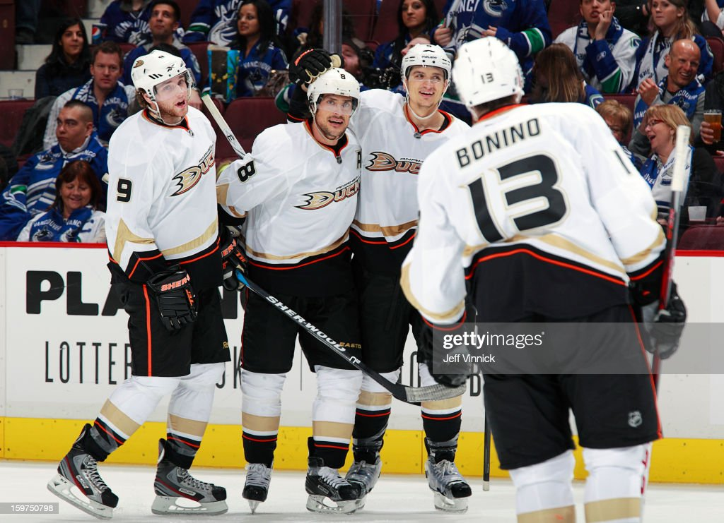 Teemu Selanne #8 of the Anaheim Ducks is congratulated by teammates Bobby Ryan #9, Luca Sbisa #5 and Nick Bonino #13 after scoring his second goal against the Vancouver Canucks during their season-opening NHL game at Rogers Arena January 19, 2013 in Vancouver, British Columbia, Canada. Anaheim won 7-3.