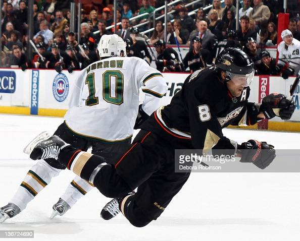 Teemu Selanne of the Anaheim Ducks is hit by Brenden Morrow of the Dallas Stars during the game on January 10 2012 at Honda Center in Anaheim...