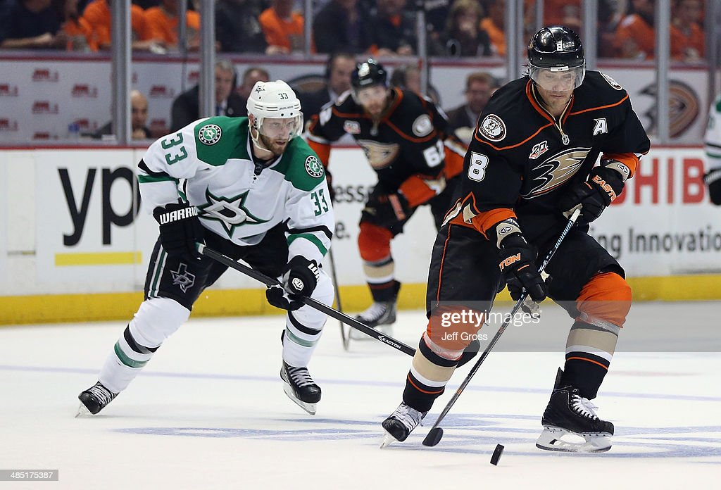 Teemu Selanne #8 of the Anaheim Ducks is pursued by <a gi-track='captionPersonalityLinkClicked' href=/galleries/search?phrase=Alex+Goligoski&family=editorial&specificpeople=791866 ng-click='$event.stopPropagation()'>Alex Goligoski</a> #33 of the Dallas Stars for the puck in the third period of Game One of the First Round of the 2014 NHL Stanley Cup Playoffs at Honda Center on April 16, 2014 in Anaheim, California. The Ducks defeated the Stars 4-3.