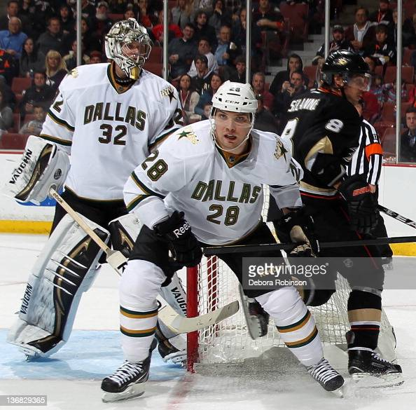 Teemu Selanne of the Anaheim Ducks looks for the puck outside the net against Mark Fistric of the Dallas Stars during the game on January 10 2012 at...