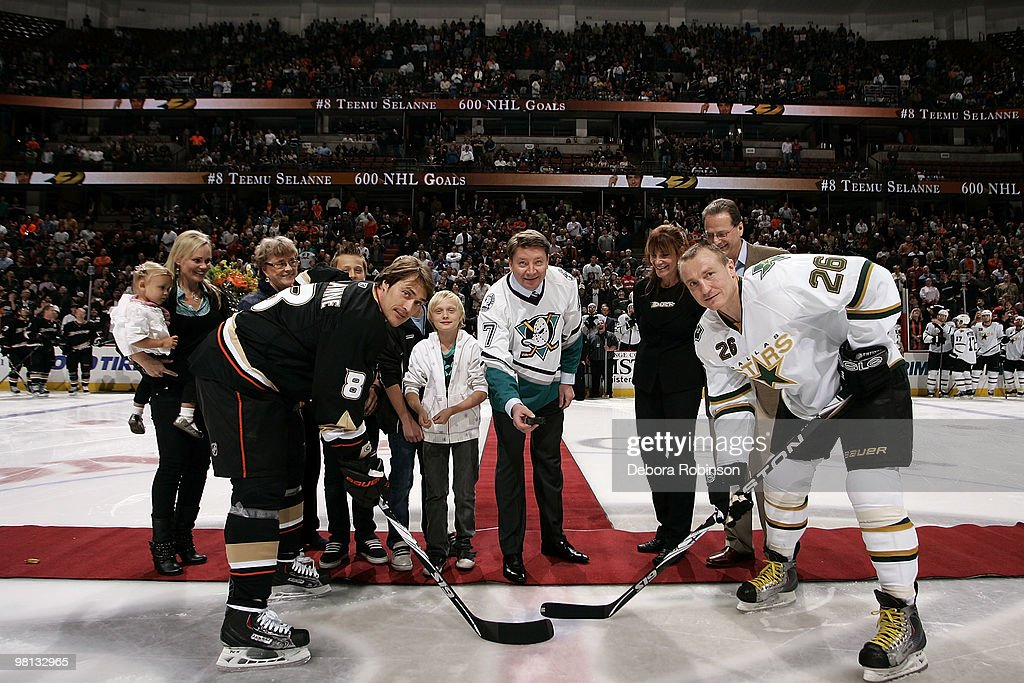 Teemu Selanne #8 of the Anaheim Ducks poses for a photo with <a gi-track='captionPersonalityLinkClicked' href=/galleries/search?phrase=Jere+Lehtinen&family=editorial&specificpeople=239506 ng-click='$event.stopPropagation()'>Jere Lehtinen</a> #26 of the Dallas Stars and former NHL player <a gi-track='captionPersonalityLinkClicked' href=/galleries/search?phrase=Jari+Kurri&family=editorial&specificpeople=600561 ng-click='$event.stopPropagation()'>Jari Kurri</a> (C) for the ceremonial puck drop prior to the game against the Dallas Stars on March 29, 2010 at Honda Center in Anaheim, California.