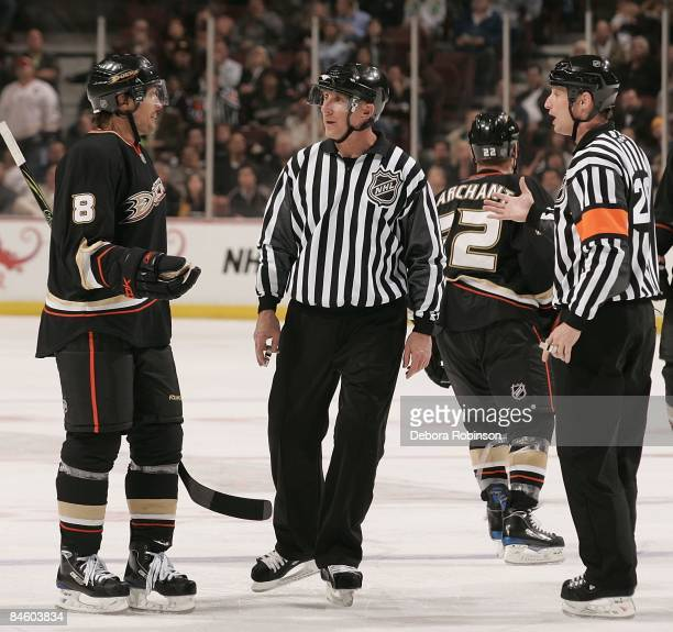 Teemu Selanne of the Anaheim Ducks questions a call with referee Chris Lee and linesman Brad Lazarowich during the third period during the against...