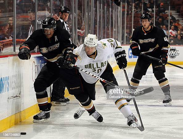 Teemu Selanne of the Anaheim Ducks races for the puck against Radek Dvorak of the Dallas Stars during the game on January 10 2012 at Honda Center in...