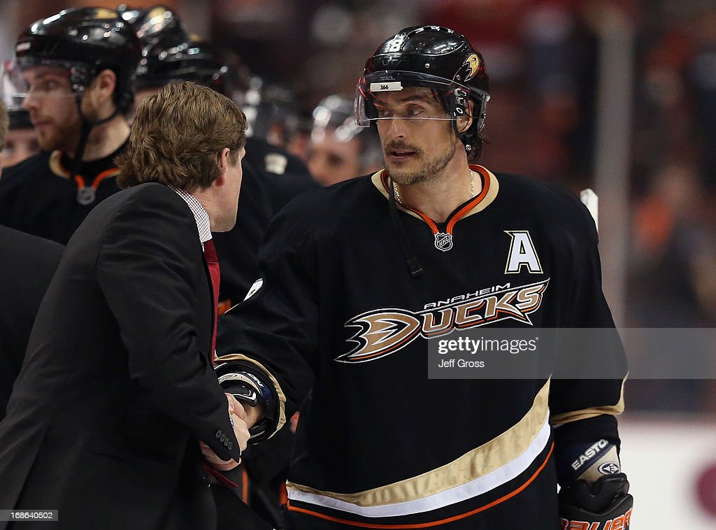 Teemu Selanne #8 of the Anaheim Ducks shakes hands with Detroit Red Wings head coach <a gi-track='captionPersonalityLinkClicked' href=/galleries/search?phrase=Mike+Babcock&family=editorial&specificpeople=226668 ng-click='$event.stopPropagation()'>Mike Babcock</a> following Game Seven of the Western Conference Quarterfinals during the 2013 NHL Stanley Cup Playoffs at Honda Center on May 12, 2013 in Anaheim, California. The Red Wings defeated the Ducks 3-2.