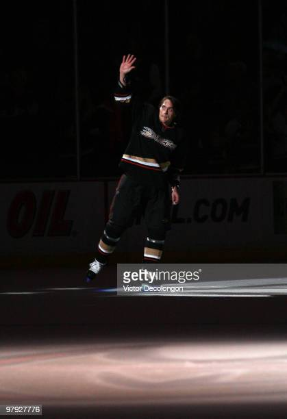 Teemu Selanne of the Anaheim Ducks skates to center ice to acknowledge the fans after the game against the Colorado Avalanche in which Selanne scored...