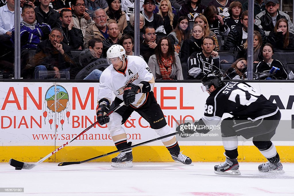 Teemu Selanne #8 of the Anaheim Ducks skates with the puck against Jarret Stoll #28 of the Los Angeles Kings at Staples Center on February 25, 2013 in Los Angeles, California.