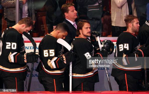 Teemu Selanne of the Anaheim Ducks stands for the national anthem before the game against the San Jose Sharks on March 25 2013 at Honda Center in...