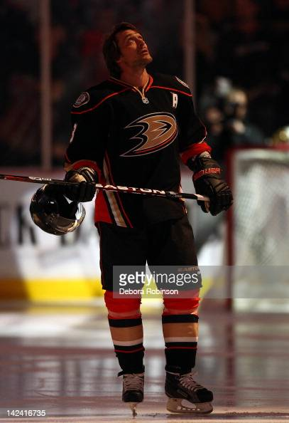 Teemu Selanne of the Anaheim Ducks stands on the ice as the National Anthem is sung before the game against the Edmonton Oilers on April 1 2012 at...