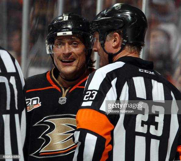 Teemu Selanne of the Anaheim Ducks talks with referee Brad Watson during the game against the San Jose Sharks on December 31 2013 at Honda Center in...