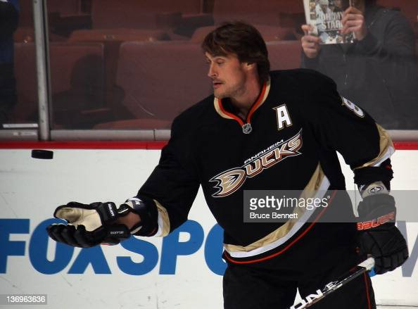Teemu Selanne of the Anaheim Ducks throws a puck to fans during warmups prior to the game against the Dallas Stars at the Honda Center on January 10...