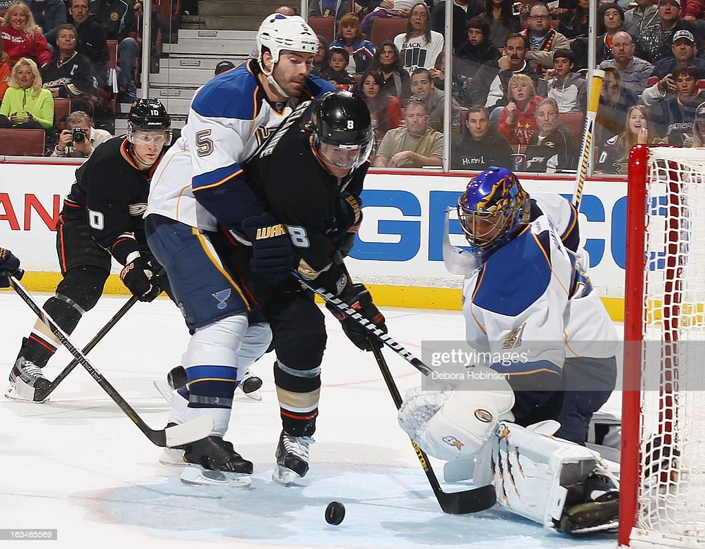 Teemu Selanne #8 of the Anaheim Ducks tries to get a shot at goal past Barret Jackman #5 and goalie Jaroslav Halak #41 of the St. Louis Blues while teammate Corey Perry watches on March 10, 2013 at Honda Center in Anaheim, California.