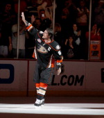 Teemu Selanne of the Anaheim Ducks waves to the crowd after playing his last regular season game in the NHL against the Colorado Avalanche on April...