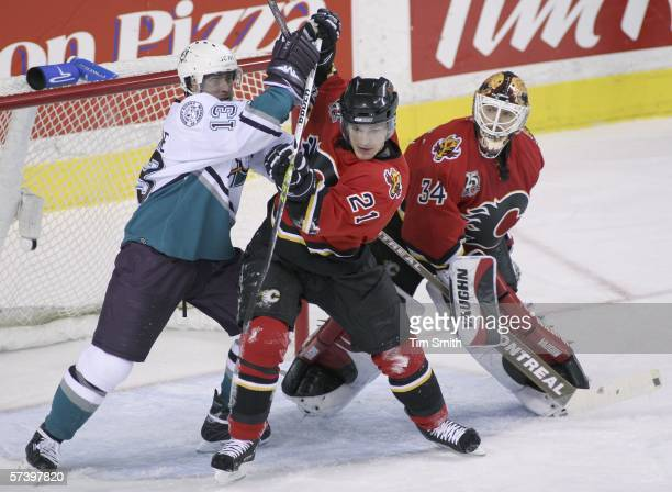 Teemu Selanne of the Anaheim Mighty Ducks battles for position against Andrew Ference and goalie Miikka Kiprusoff of the Calgary Flames during second...