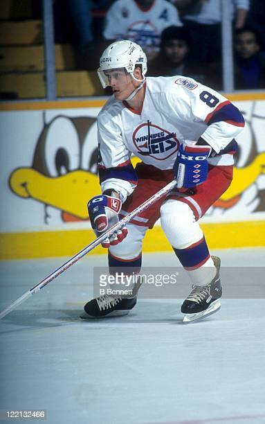 Teemu Selanne of the Winnipeg Jets skates on the ice during an NHL game in April 1995 at the Winnipeg Arena in Winnipeg Manitoba Canada