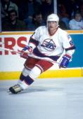 Teemu Selanne of the Winnipeg Jets skates on the ice during an NHL game circa 1995 at the Winnipeg Arena in Winnipeg Manitoba Canada