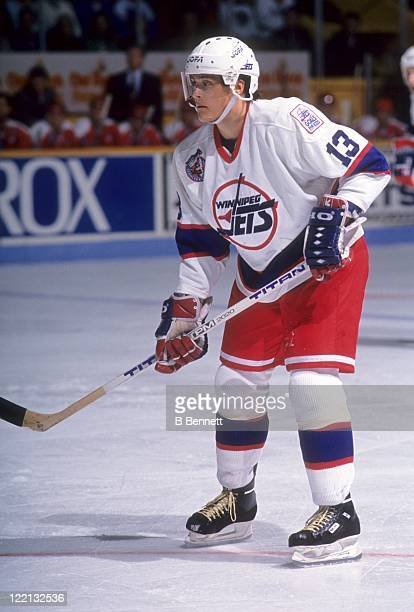 Teemu Selanne of the Winnipeg Jets skates on the ice during an NHL game against the Washington Capitals on October 26 1992 at the Winnipeg Arena in...