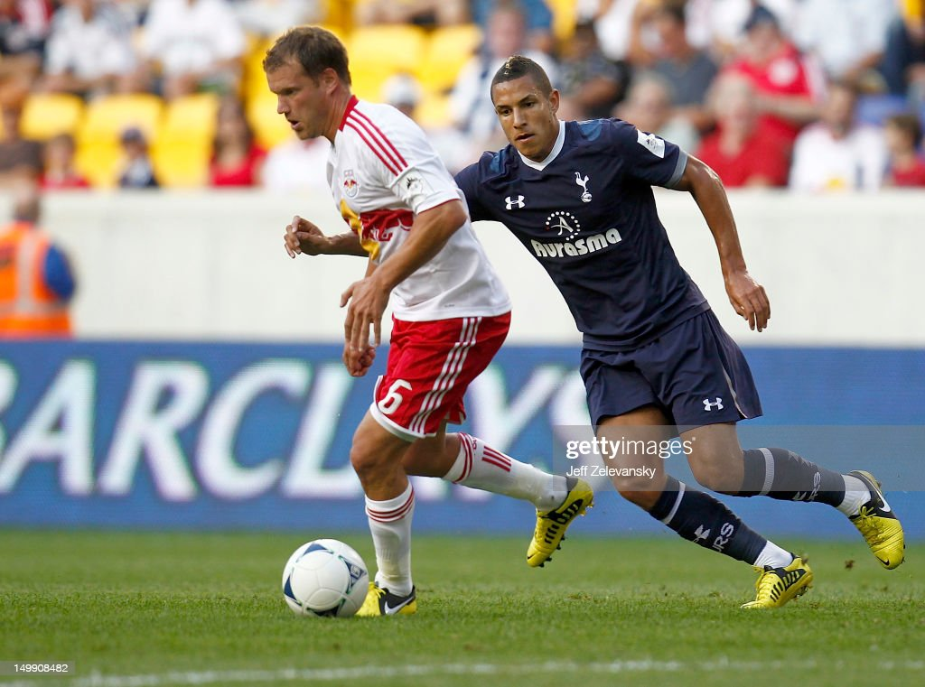 Teemu Tainio #6 of New York Red Bulls drives in front of Jake Livermore #29 of Tottenham Hotspur during their match at Red Bull Arena on July 31, 2012 in Harrison, New Jersey.