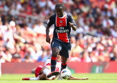 Teemu Tainio of New York Red Bulls tackles Peguy Luyindula of Paris St Germain during the Emirates Cup match between New York Red Bulls and Paris St...