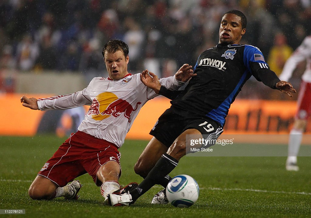Teemu Tainio #2 of the New York Red Bulls and Ryan Johnson #19 of the San Jose Earthquakes battle for the ball on April 16, 2011 at Red Bull Arena in Harrison, New Jersey. The Red Bulls defeated the Earthquakes 2-0.