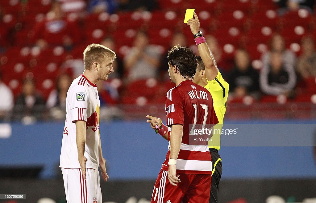 Teemu Tainio #2 of the New York Red Bulls react to a yellow card for a reckless tackle against Ricardo Villar #11 of the FC Dallas during the wild card match at Pizza Hut Park on October 26, 2011 in Frisco, Texas.