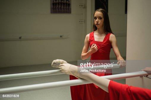 Teen Ballerina poses at Barre