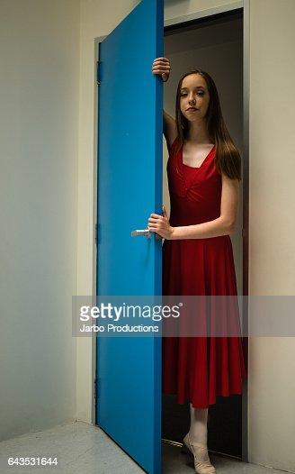 Teen Ballerina poses at studio door