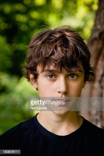 Teen boy in black t-shirt, portrait