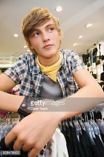 Teen boy in clothing store : Bildbanksbilder