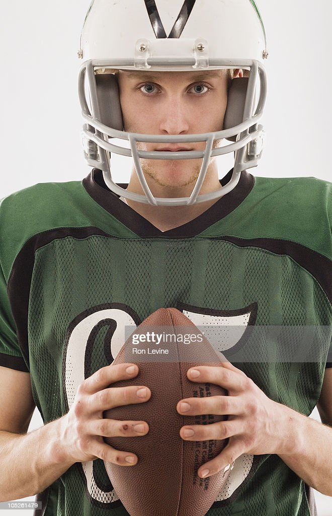 Teen boy in football gear, portrait : Stock Photo