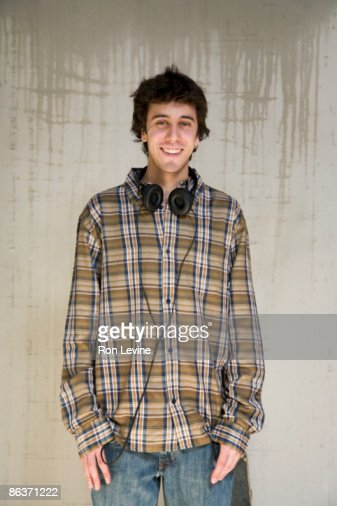 Teen boy in plaid shirt and headphones, portrait : Stock Photo