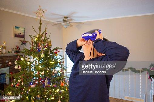 Teen boy using VR viewer at Christmas