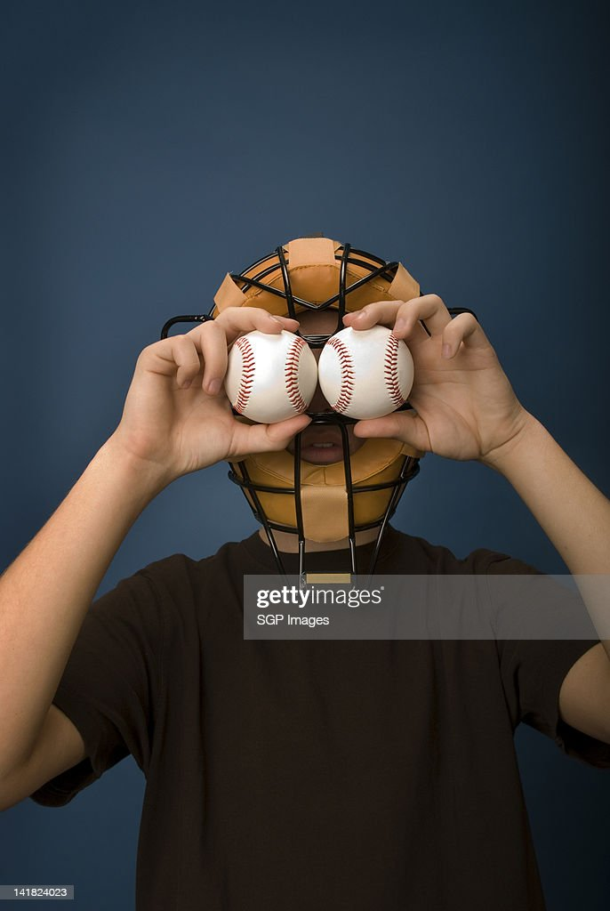 Teen boy with baseball eyes : Stock Photo