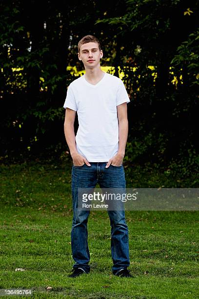 Teen boy with hands in pockets, portrait