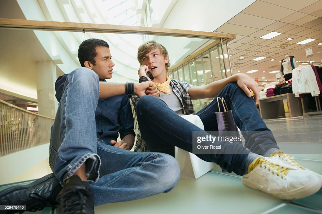 Teen boys in shopping center : Stock Photo